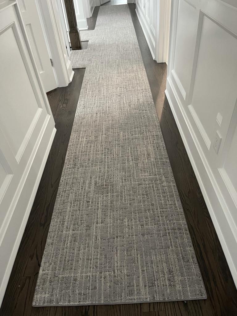 Framed Carpet Runner in a Hallway